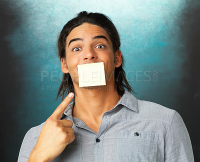 Buy stock photo Young man with adhesive tape on his mouth