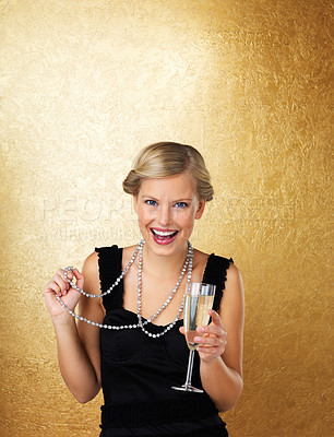 Buy stock photo Pretty woman celebrating with champagne in hand