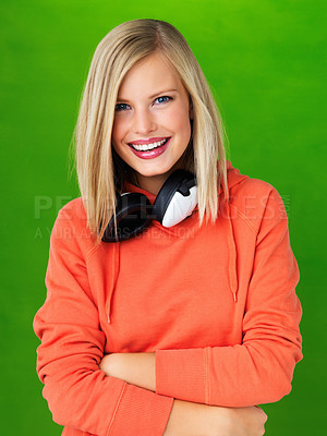 Buy stock photo Portrait of pretty woman with headphones on green background