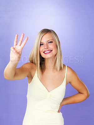 Buy stock photo Portrait of pretty woman holding up three fingers