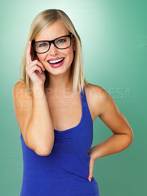 Buy stock photo Happy young female in glasses on green background