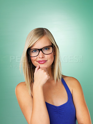 Buy stock photo Young girl in glasses with hand on chin