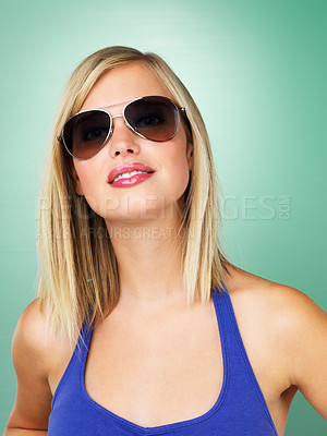 Buy stock photo Trendy woman in sunglasses on green background