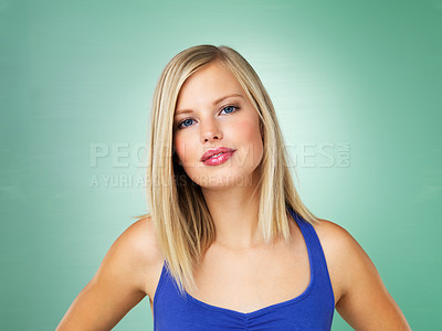 Buy stock photo Closeup of attractive young woman on green background