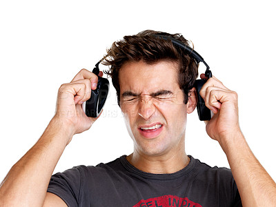 Buy stock photo Portrait of young man expressing loud sound over the headphone on white background