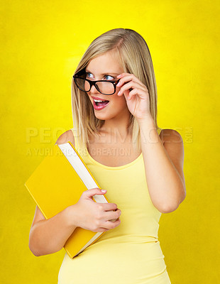 Buy stock photo Pretty blonde woman looking over the top of her glasses while smiling