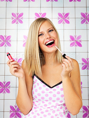 Buy stock photo Attractive woman putting on lip gloss indoors