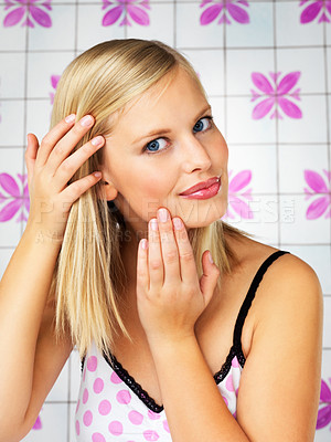Buy stock photo Pretty woman looking at her complexion indoors