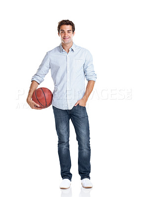Buy stock photo Portrait of a handsome young man holding a basketball on white background