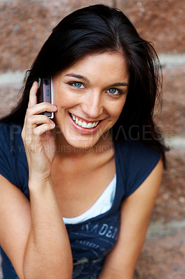 Buy stock photo Portrait of an attractive young girl talkng on mobile phone against the wall