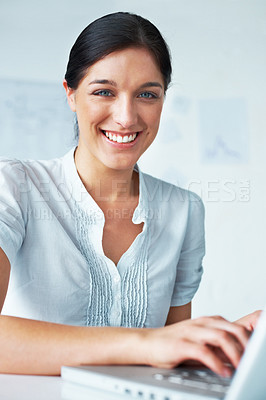Buy stock photo Portrait of a smiling young business lady working on laptop in the office