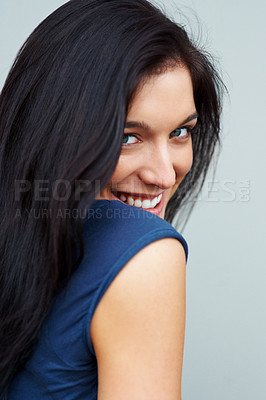 Buy stock photo Closeup portrait of a cute young woman smiling against grey background