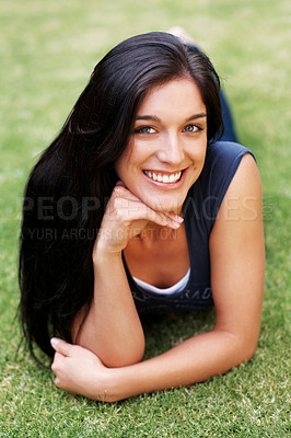 Buy stock photo Portrait of a happy young lady lying on grass at the park - Outdoor