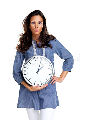 Buy stock photo Portrait of a young woman holding a clock in hand against white background