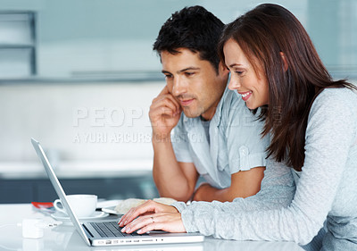 Buy stock photo Portrait of a beautiful young couple working together on laptop - Indoor