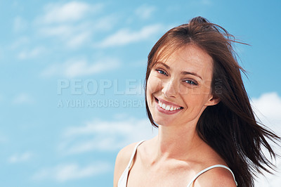 Buy stock photo Portrait of a beautiful young woman smiling against the sky - Outdoor
