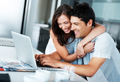 Buy stock photo Portrait of a smiling young couple surfing internet on laptop in kitchen at home