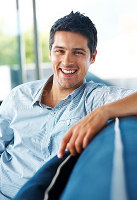 Buy stock photo Portrait of a smart young guy sitting on couch at home - Indoor