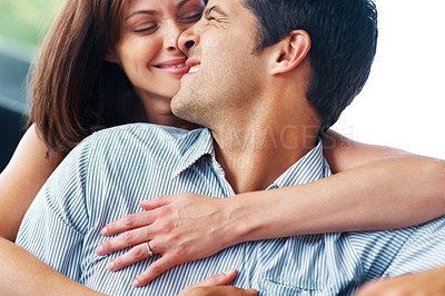Buy stock photo Closeup portrait of a romantic young couple in a playful mood