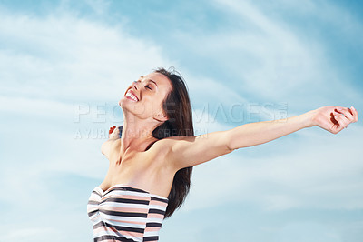 Buy stock photo Portrait of a sexy young female enjoying her independence with hands outstretched