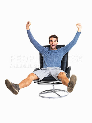 Buy stock photo Full length of a joyful man kicking out legs and throwing up arms in excitement