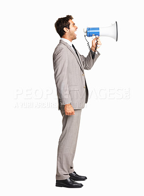 Buy stock photo Side view of young business man shouting on megaphone over white background