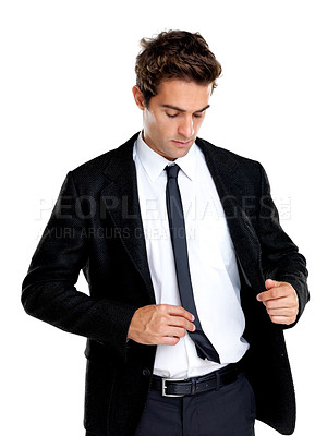 Buy stock photo Portrait of a handsome young male adjusting his tie against white background