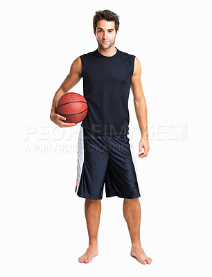 Buy stock photo Assertive athletic man holding a basketball