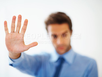Buy stock photo Young business man making stop gesture