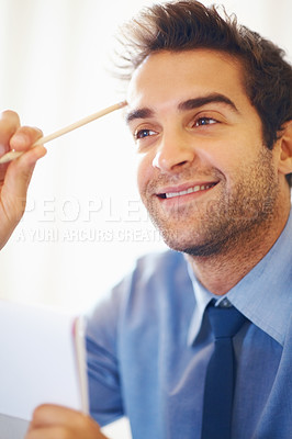 Buy stock photo Smiling business man with pencil in hand looking away