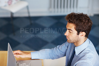 Buy stock photo Serious business man working on laptop