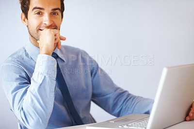 Buy stock photo Portrait of young confident business man with laptop