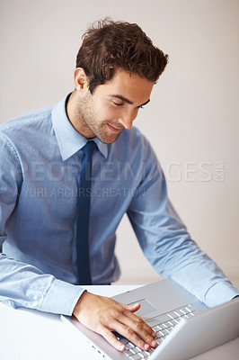 Buy stock photo Portrait of young business man working on laptop