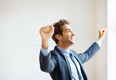 Buy stock photo Businessman lifting arms in excitement