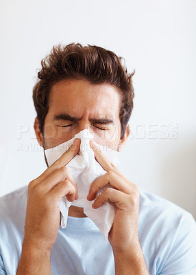 Buy stock photo Man blowing his nose
