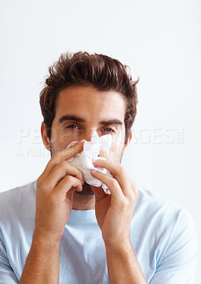 Buy stock photo Man with tissue looking like he has cold