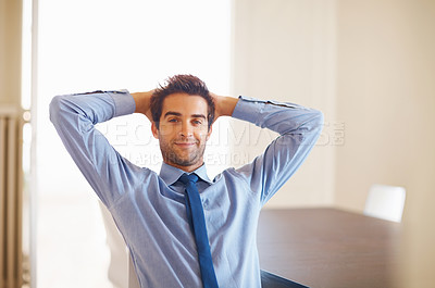 Buy stock photo Businessman relaxing with hands behind head