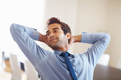Buy stock photo Executive contemplating with hands behind head