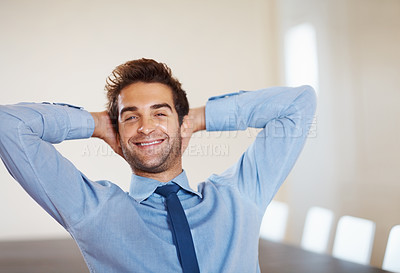 Buy stock photo Businessman smiling while relaxing with hands behind head