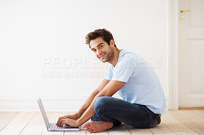 Buy stock photo Portrait of smiling man sitting on floor, working on laptop