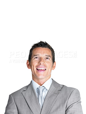 Buy stock photo Portrait of a joyful young male entrepreneur looking upward at copyspace against white background