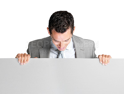 Buy stock photo Portrait of a young business man looking down at a blank billboard against white background