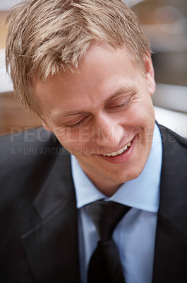 Buy stock photo A trendy European businessman with a blue tie and shirt. The picture is taken outdoors on a restaurant set.