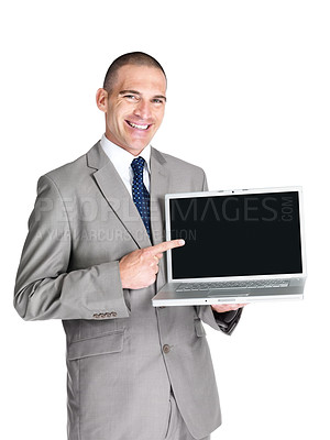 Buy stock photo Portrait of a smiling young business man pointing at laptop screen against white background