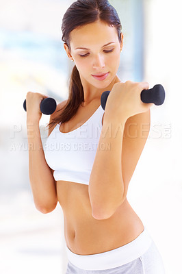 Buy stock photo Portrait of fitness woman working out with free weights in gym