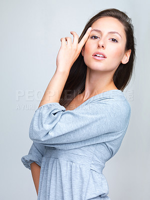 Buy stock photo Portrait of a beautiful young woman posing against grey background