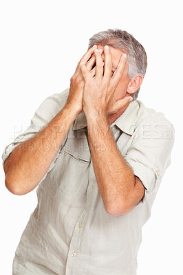 Buy stock photo Studio shot of a mature man covering his face with his hands against a white background