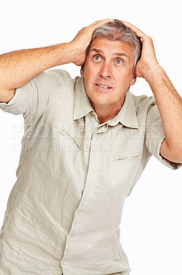 Buy stock photo Studio shot of a mature man looking surprised against a white background