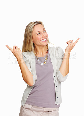 Buy stock photo Beautiful business woman pointing with both hands over white background