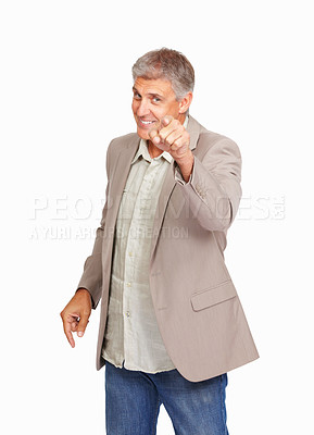 Buy stock photo Studio shot of a mature man pointing at you against a white background